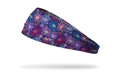 purple headband with repeating pattern of bright gem jewel colored tropical flowers