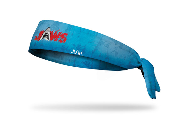 blue and navy headband made to look like water with Jaws logo in red