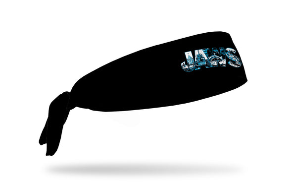 black headband with Jaws logo containing sketches of scenes from the movie Jaws