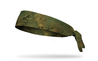 green headband with tonal colored original Jurassic Park logo