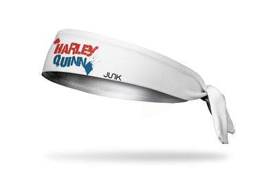 white headband with Harley Quinn wordmark graffiti logo in red and blue