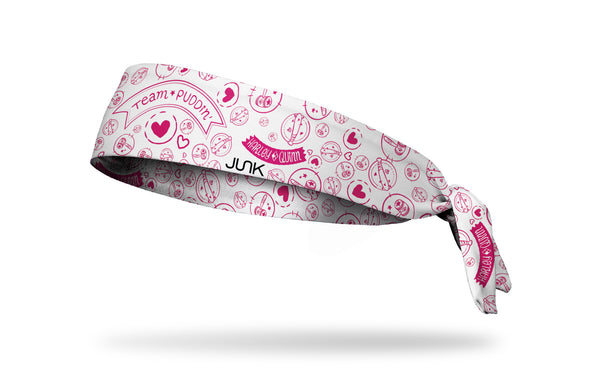 white headband with Harley Quinn Team Puddin' across front and Harley themed doodles in pink