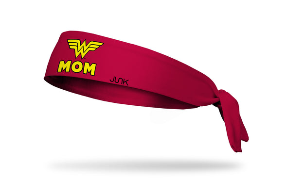 red headband with DC Comics Wonder Woman logo above mom wordmark in yellow
