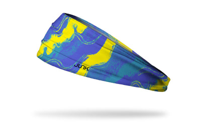 blue headband with wavy lines throughout and yellow streaks