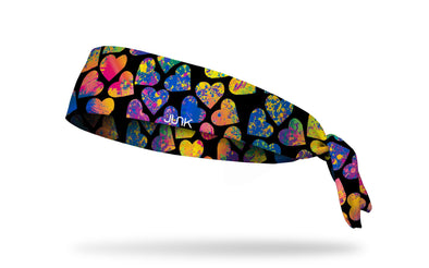black headband with bright and colorful paint splatter hearts design