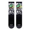 black and white dinosaur themed socks with bright green t-rex focus