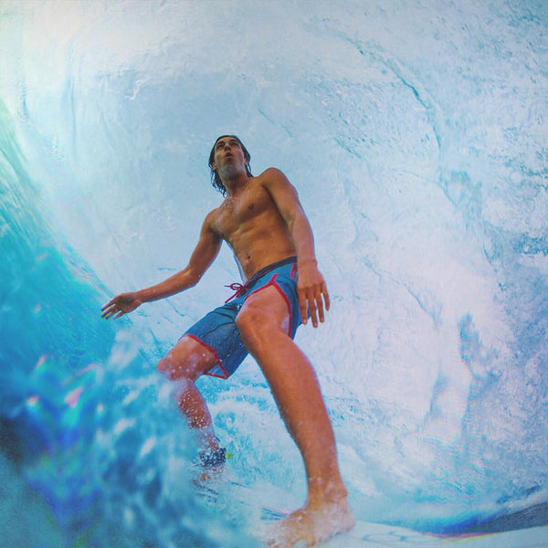 Alex Smith pro surfer in the pipe - Photo by Brent Bielmann
