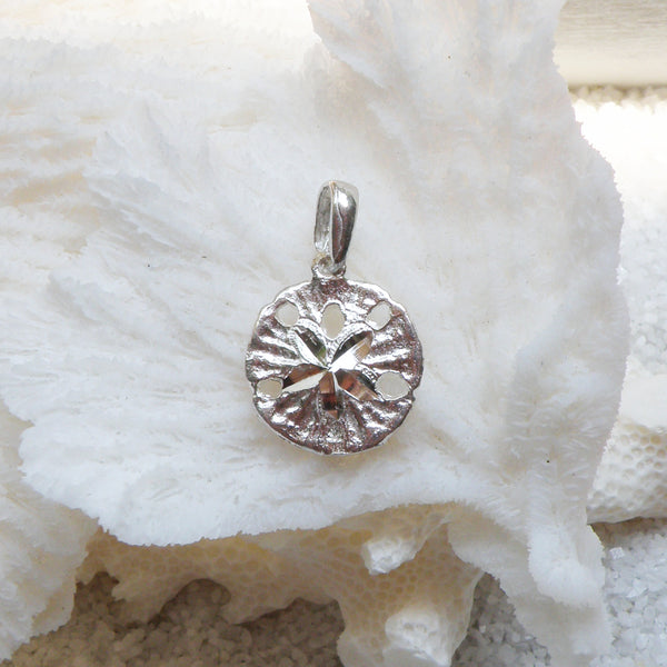 Sterling silver sand dollar charm (cut-center)