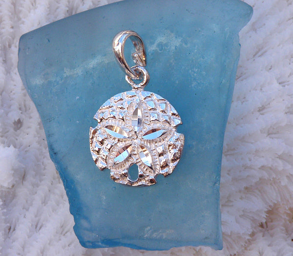 Sterling silver sand dollar charm (cut-textured)