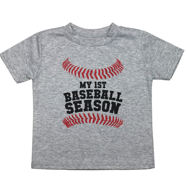 "A toddler sized t shirt with the words ""My 1st Baseball Season"" with baseball stitching above and below the text"