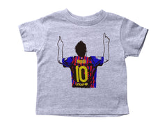 a drawing of Lionel Messi in a colored Argentina Futbol jersey on a short sleeved crewneck shirt for toddlers
