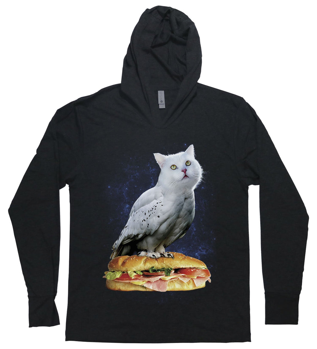 An owl with a cat head or a cat with an owl body sitting atop a sub sandwich