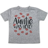 "a shirt that says ""auntie was here"" with red kisses around the text"