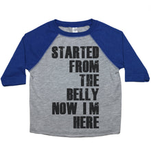 "Load image into Gallery viewer, a toddler tee with the text ""started from the belly now I'm here"""