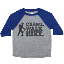 "Load image into Gallery viewer, a toddler tee with the text ""Crawl. Walk. HIke."" stacked on top of one another with a stick figure with a walking stick next to it"