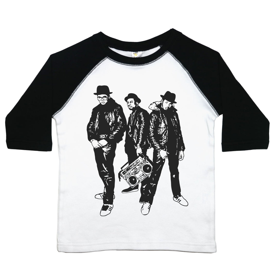 a toddler tee with a drawing of all three members of run dmc