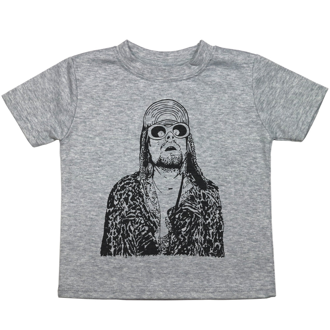 a toddler tee with a drawing of kurt cobain in sunglasses and a jacket