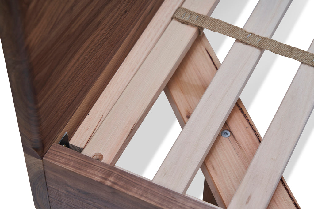 Close up of solid timber on divine bed