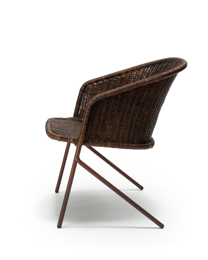 Kakī lounge chair (oxide red frame / rust rattan slimit) side