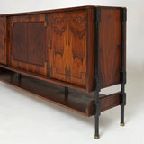 Elegant mid century Italian  sideboard featuring a central bar .