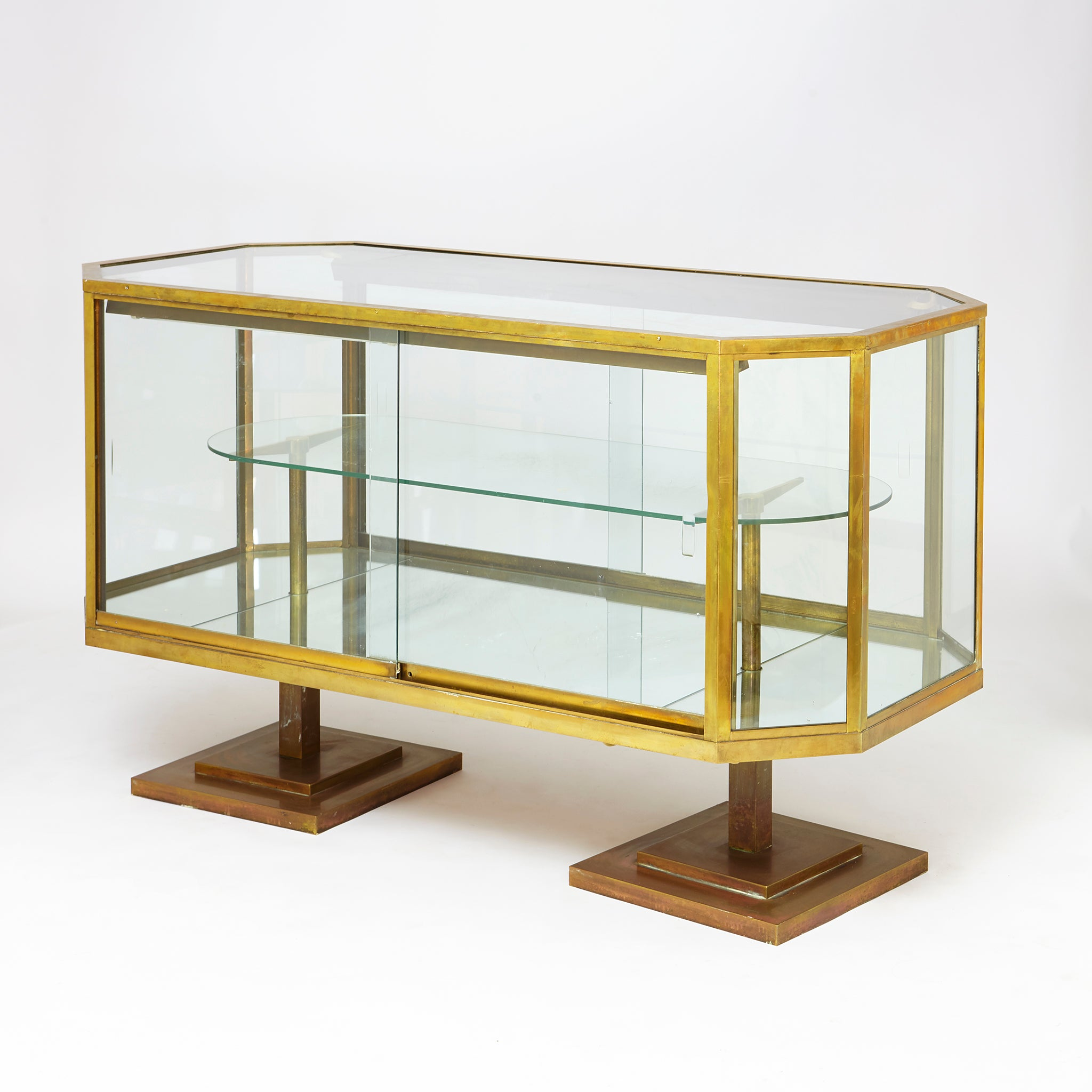 A Fine Art deco bronze display cabinet with sliding glass doors .
