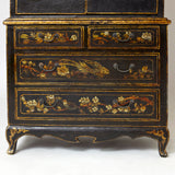 Charming dwarf cabinet with naturalistic decorations and gilt details.