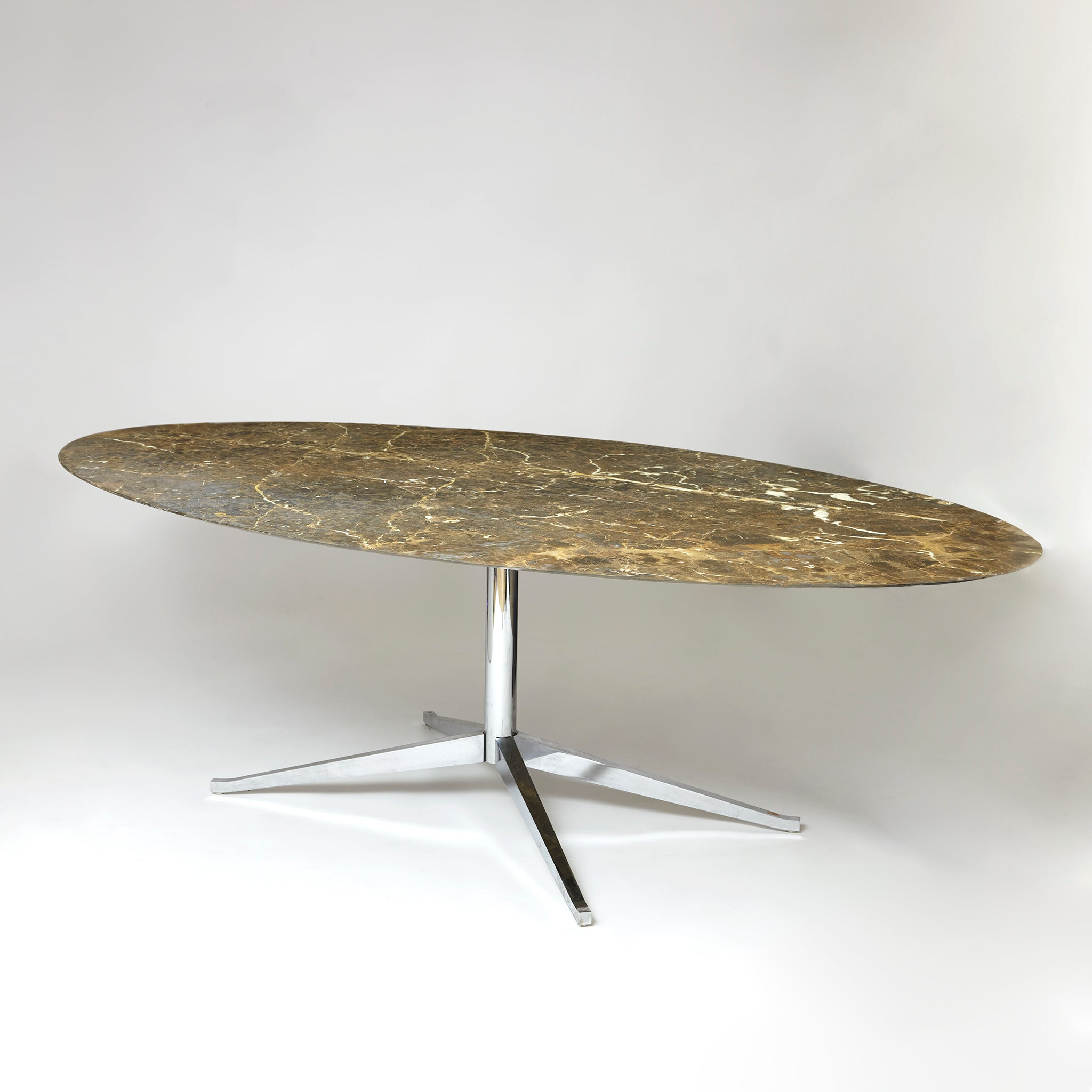 Large Florence Knoll oval dinning table with espresso marble top .