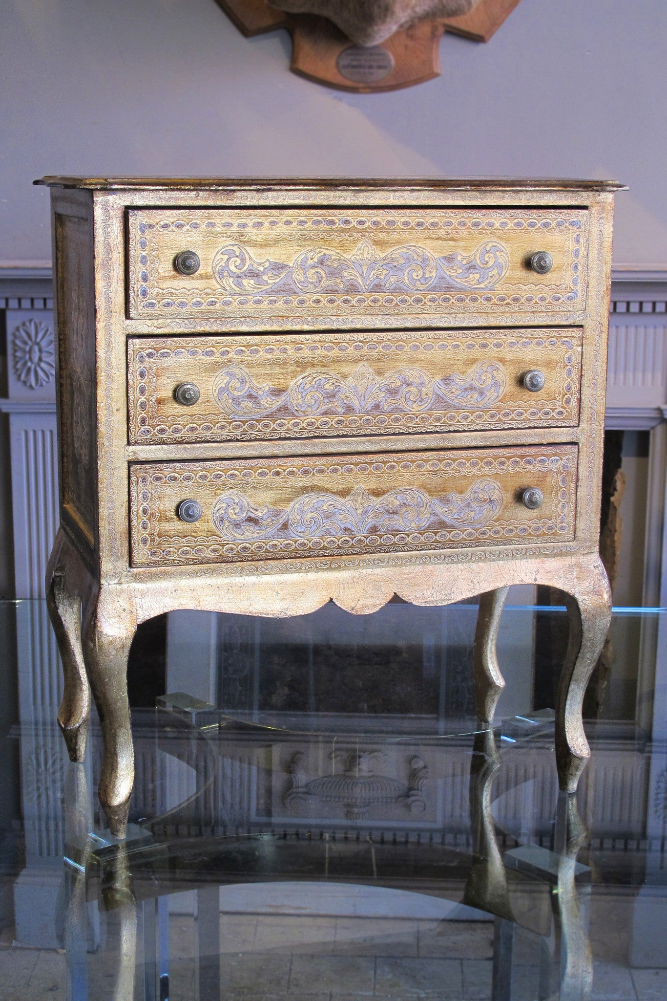 Gilt chest of drawers.