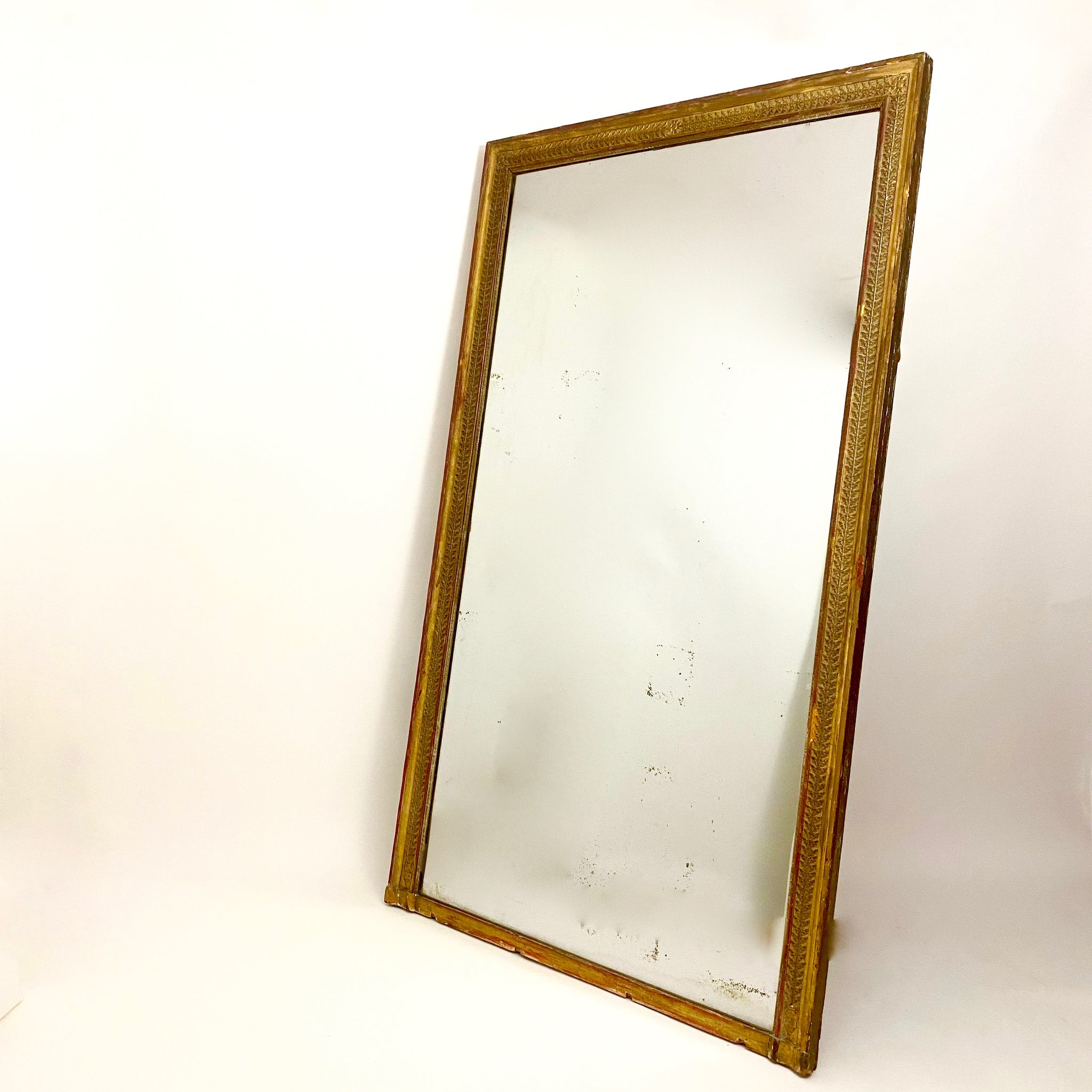 Stunning French , floor standing  gilt mirror with mercury glass plate .