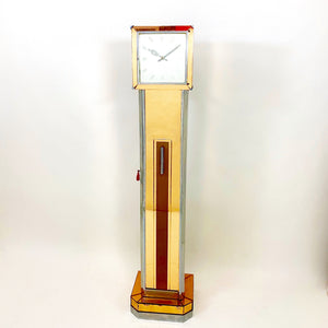 A mirrored Art Deco cocktail cabinet modelled as a long case clock .