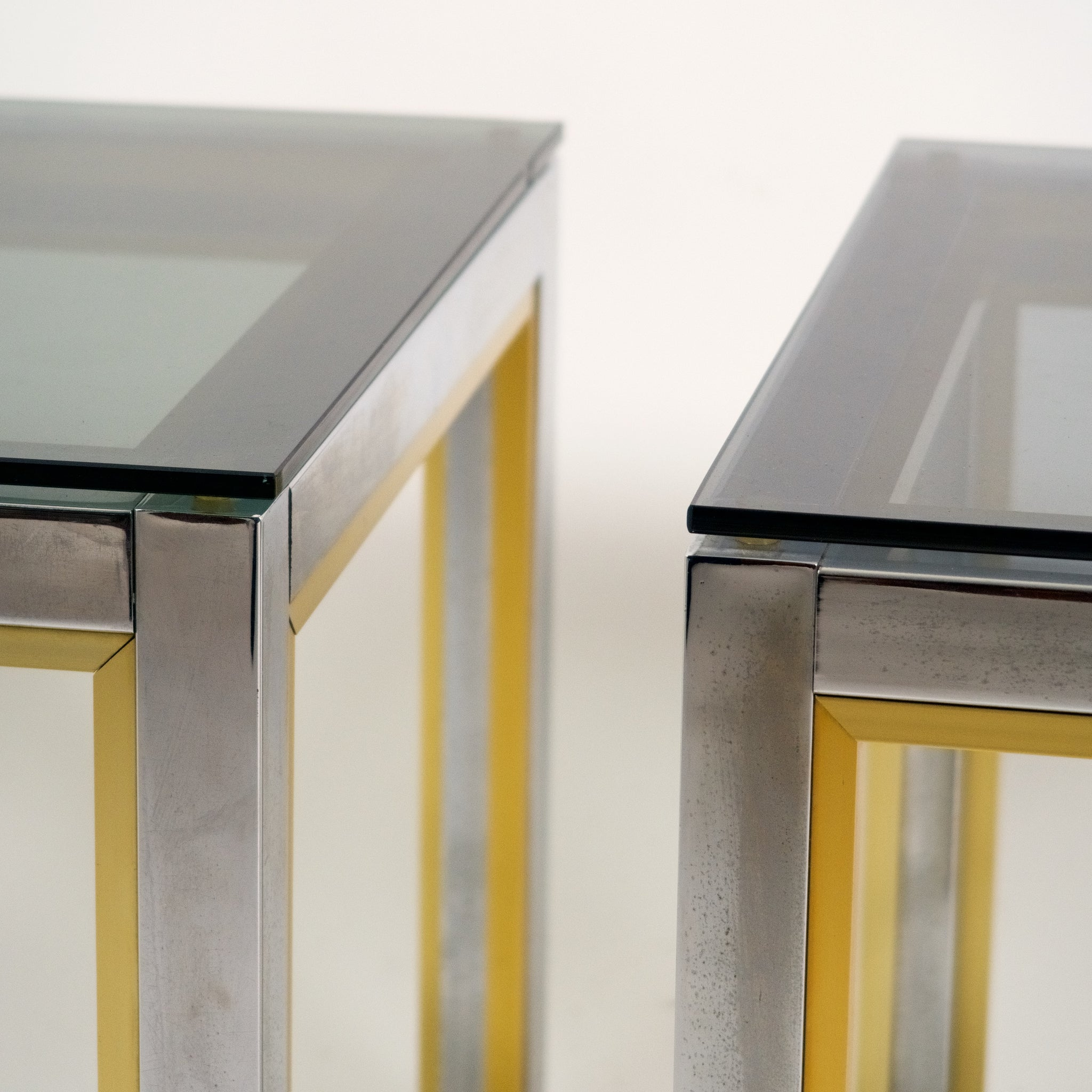 Pair of Italian mid century chrome and gold side tables .