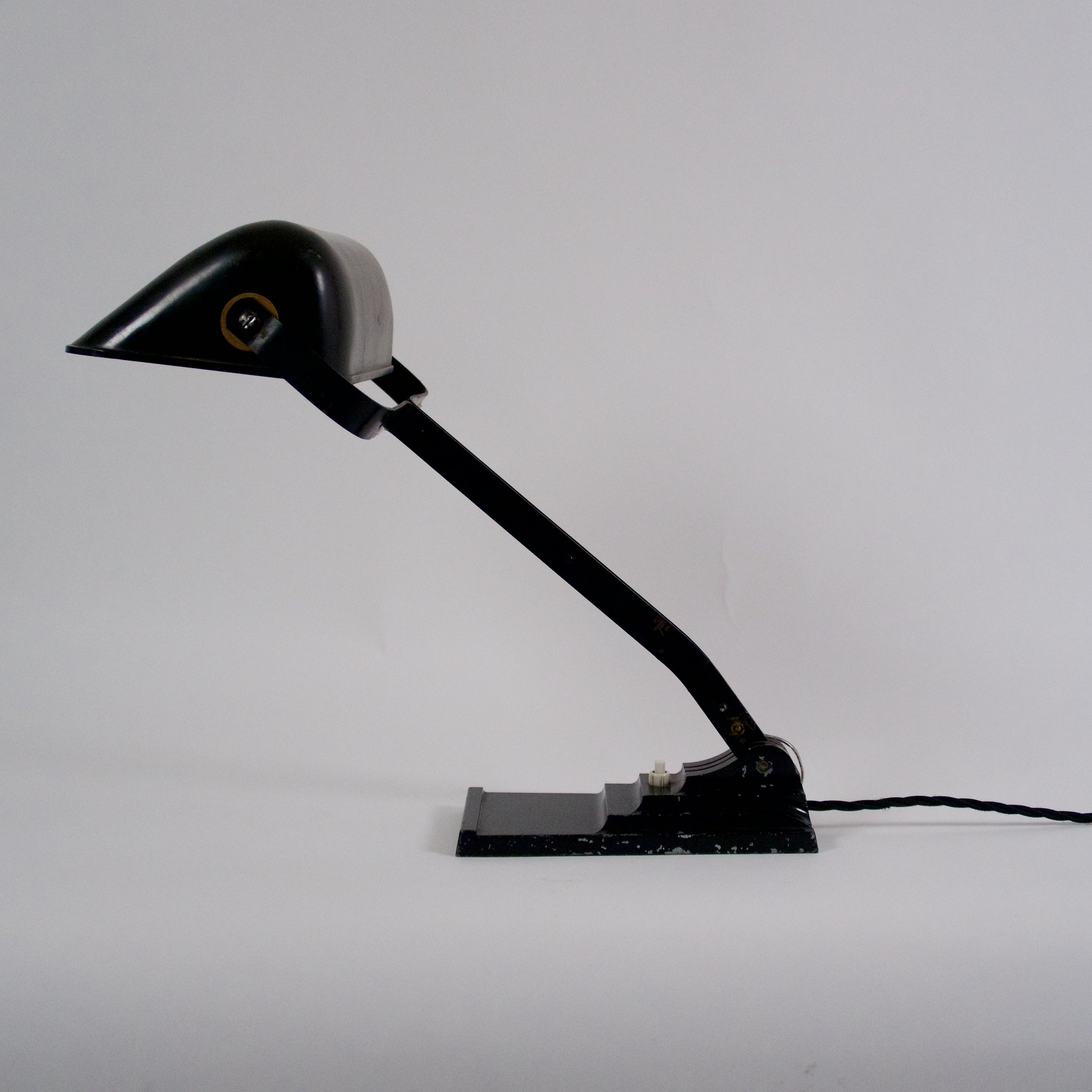 Art deco desk lamp with articulated top by ERPE .