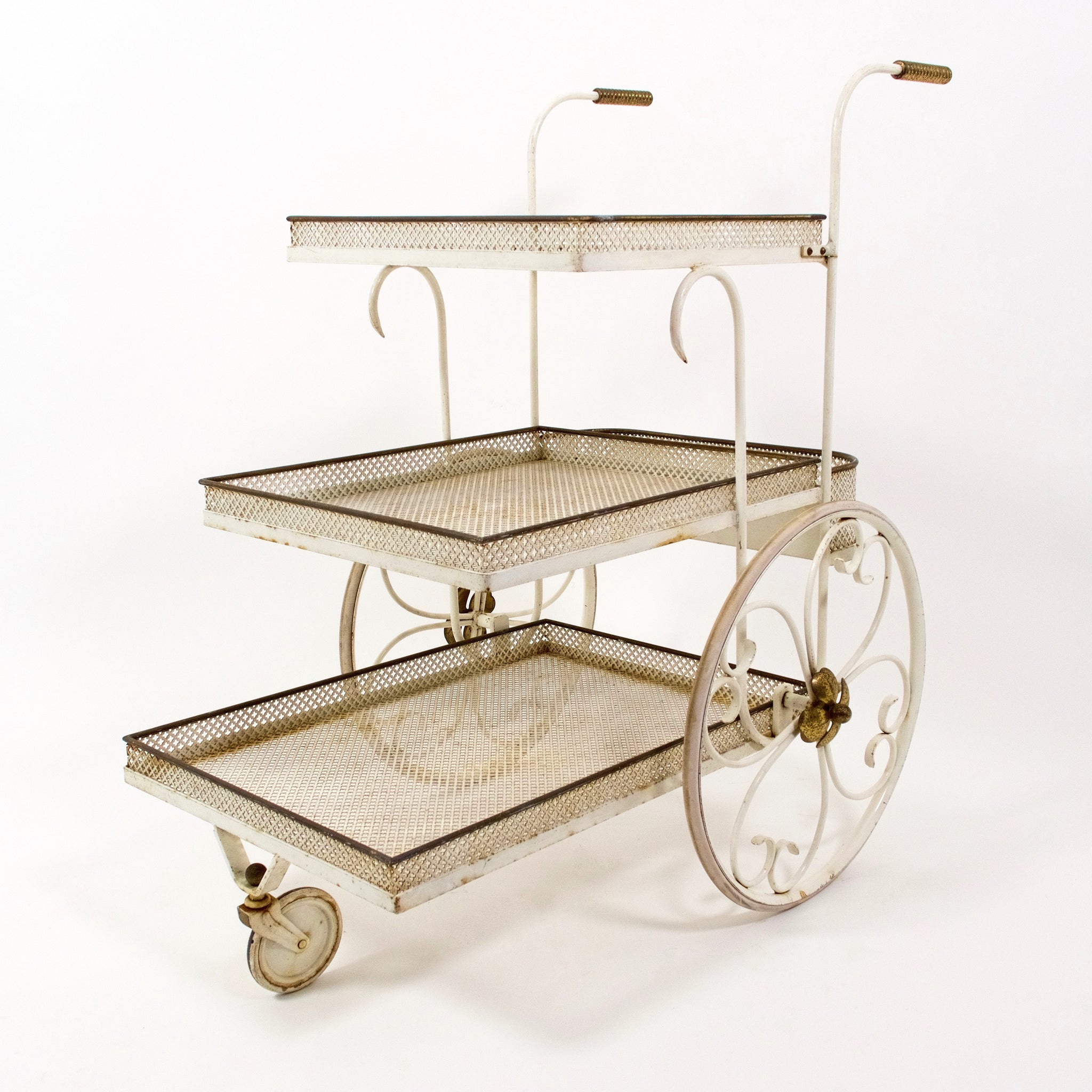 Vintage french bar cart in the style of Mathieu Mategot .