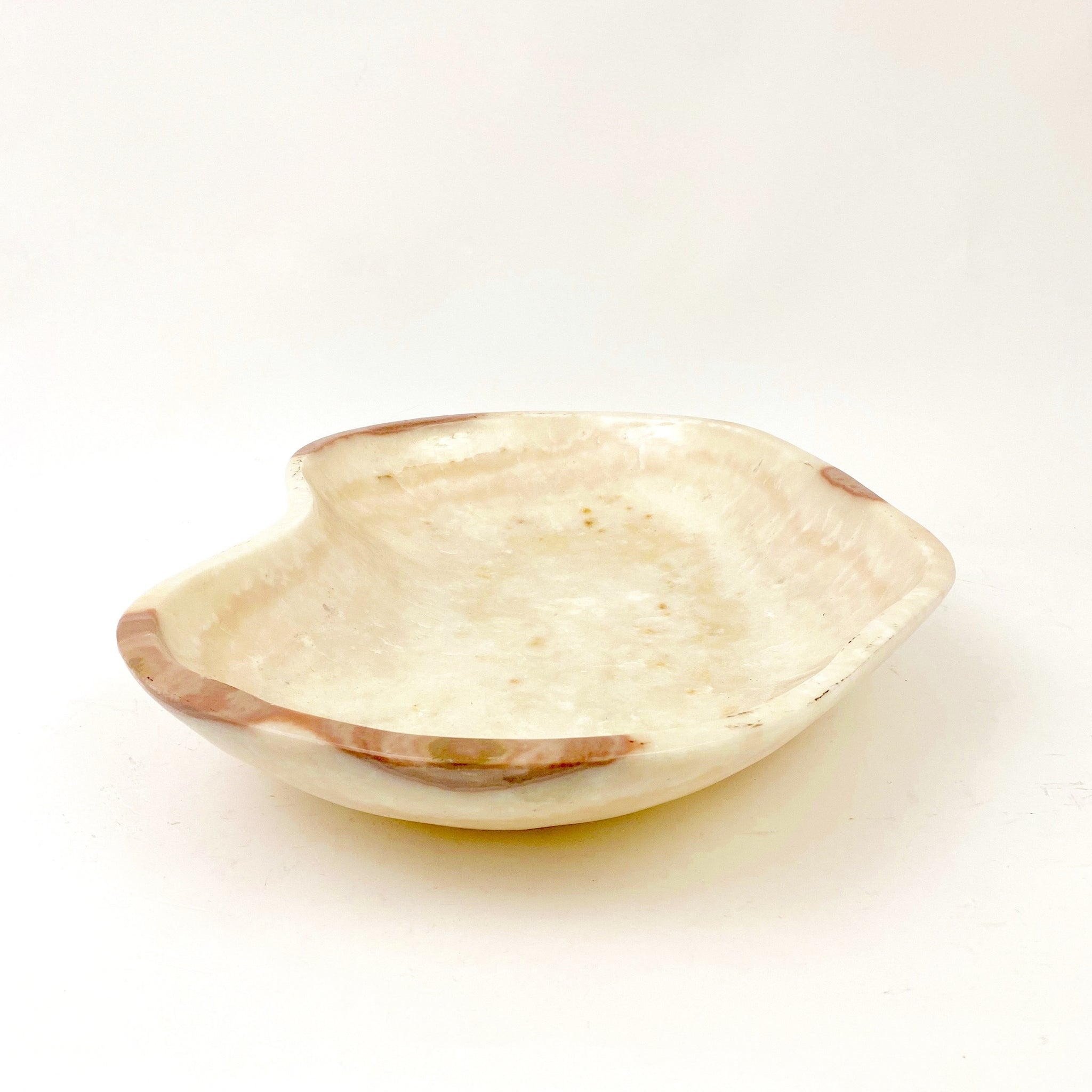 Large hand polished alabaster bowl .