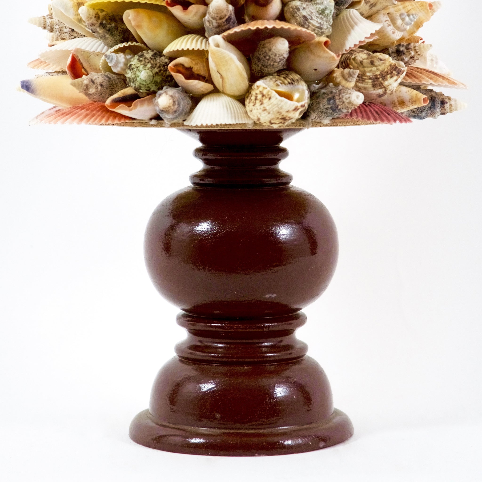 Decorative shell Christmas trees on wooden bases.