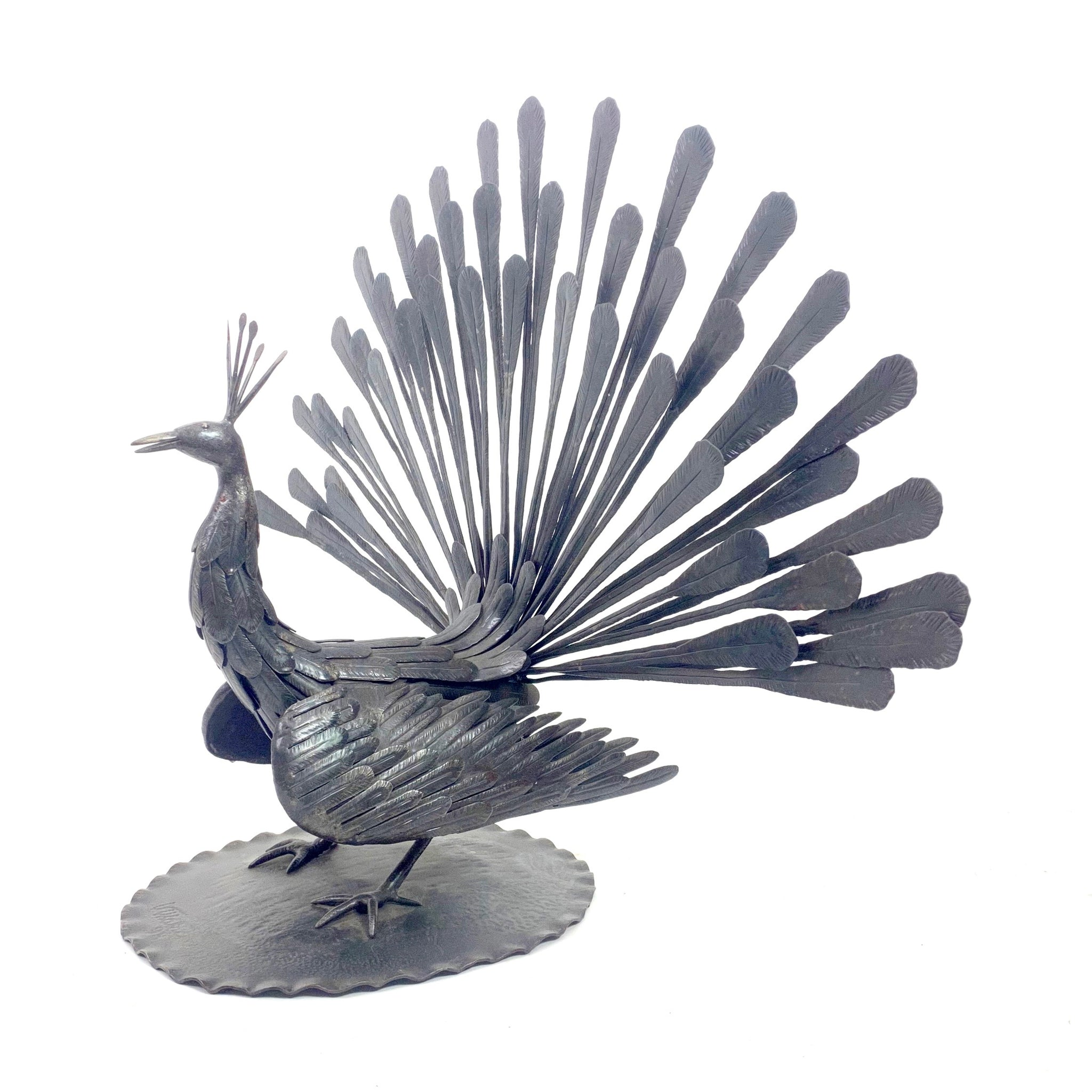 Large, hand wrought, iron peacock sculpture .