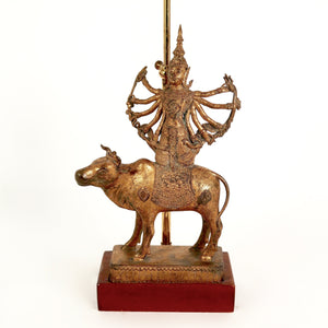 A decorative 1970's french lamp featuring a bronze asian deity  .