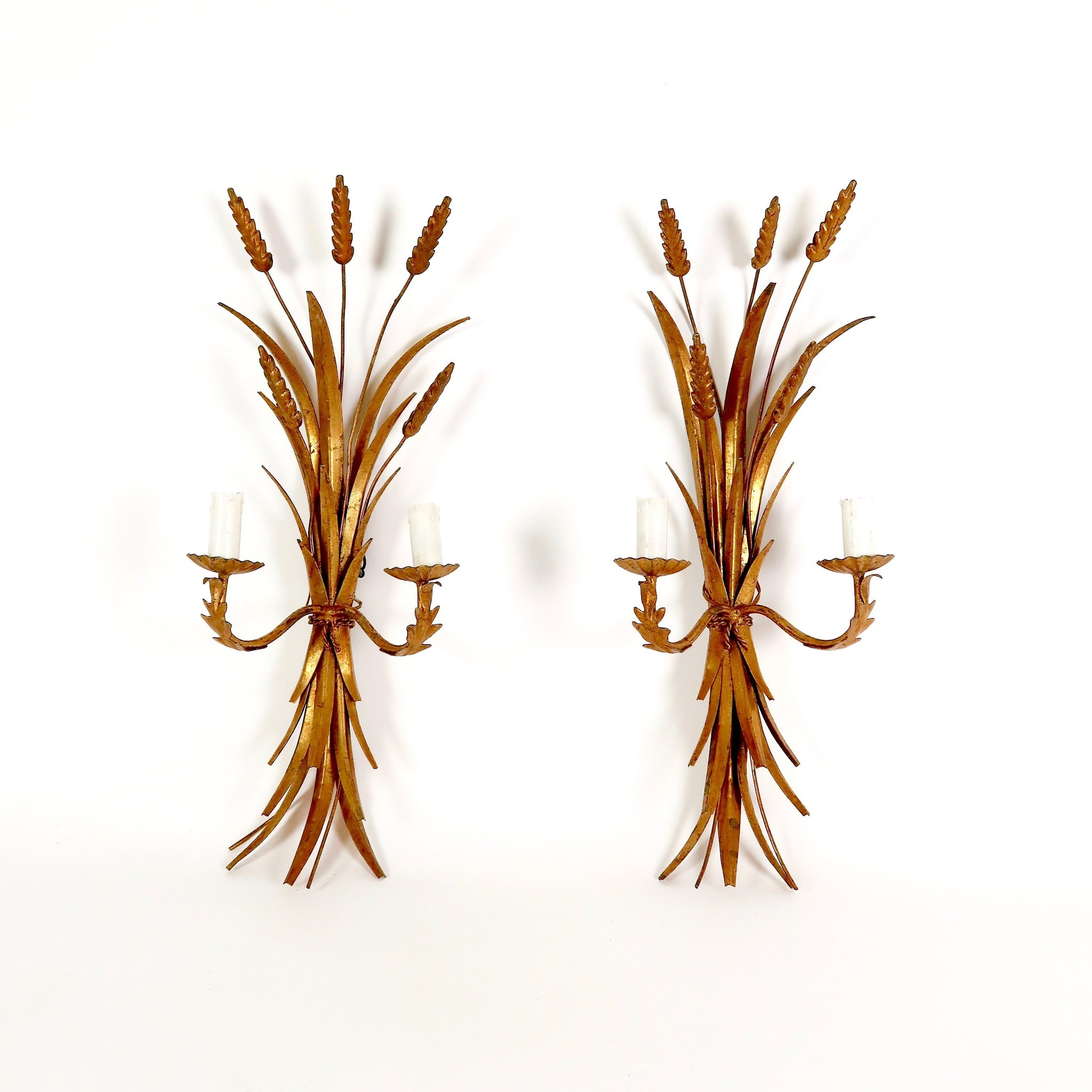 Pair of gilt metal wheat sheaf wall lights in the Coco Chanel style .