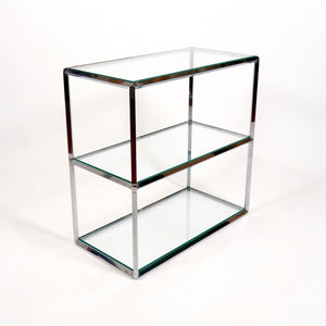 Elegant pair of  vintage modernist chrome low shelving units.