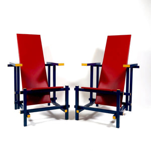 Pair of striking modernist vintage  chairs of cantileverd form with padded seat  .