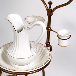 Decorative tubular brass vintage  washstand with ceramic jug and bowl .