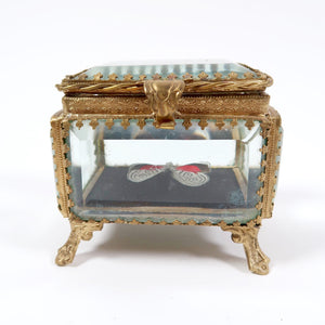 Les Couilles du Chien mounted butterfly in gilt metal jewellery casket.
