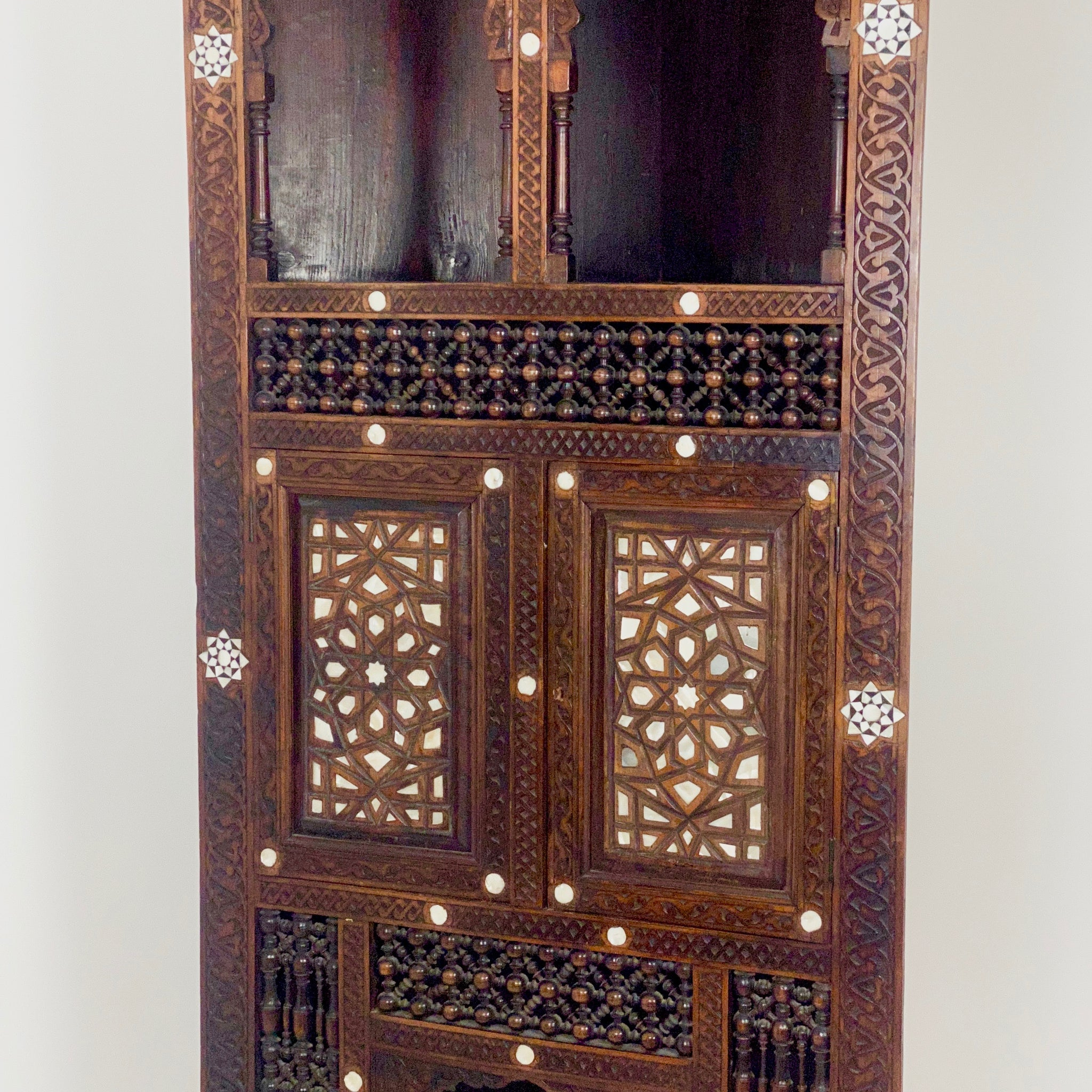A late 19th century Syrian corner cupboard.