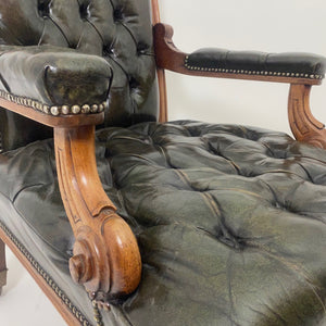 Pair of gentleman's library chairs with deep buttoned leather seats .