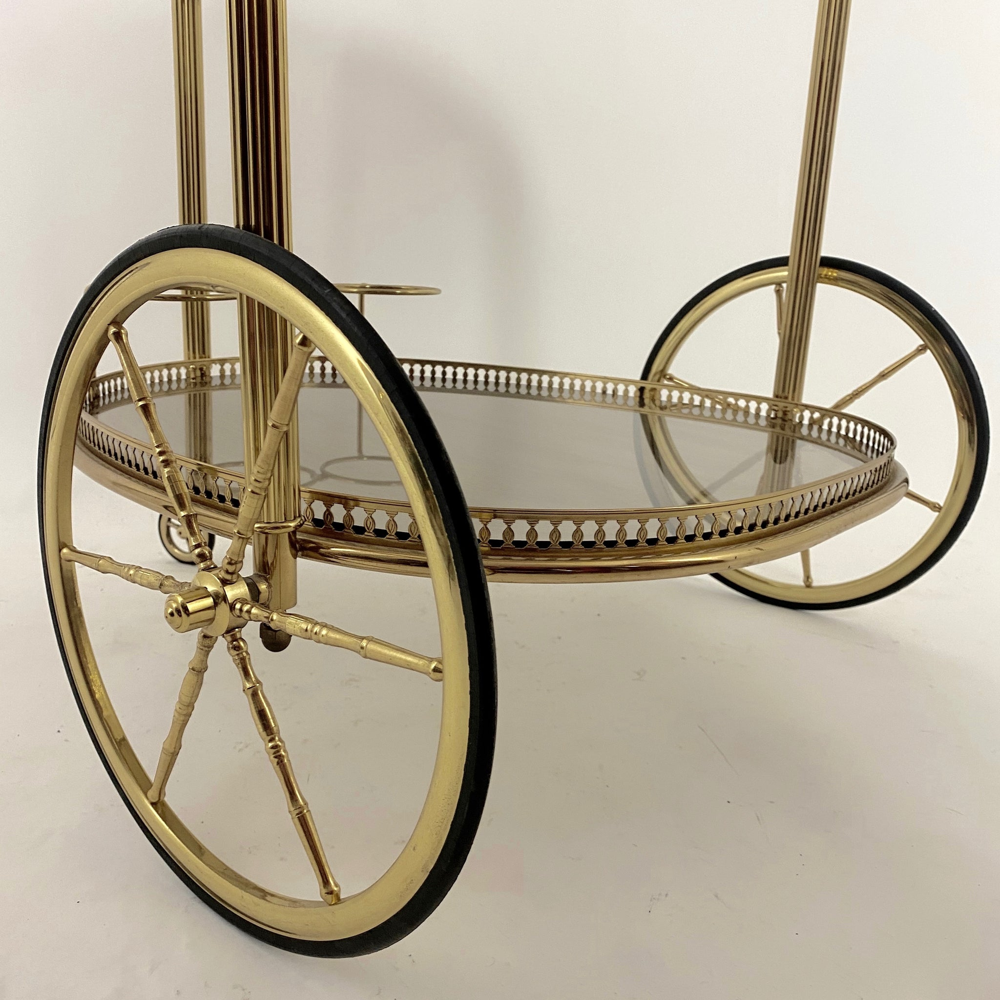 Decorative vintage brass bar cart .