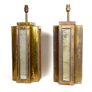 Stylish pair of patinated metal lamps in the style of Dubarry .
