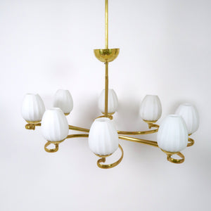 Stylish Italian mid century brass chandelier with opaque glass shades.
