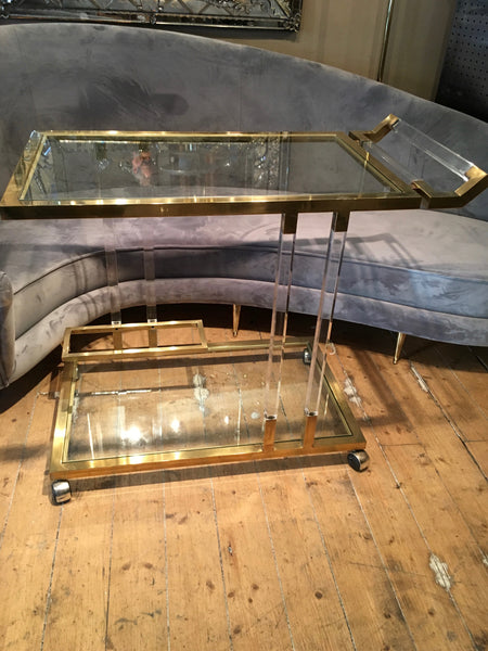 Chique and fabulous 1970's lucite and brass Bar trolley .