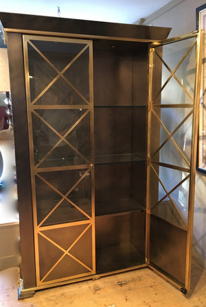 Steel and brass bookcase with classical  details circa 1970 .