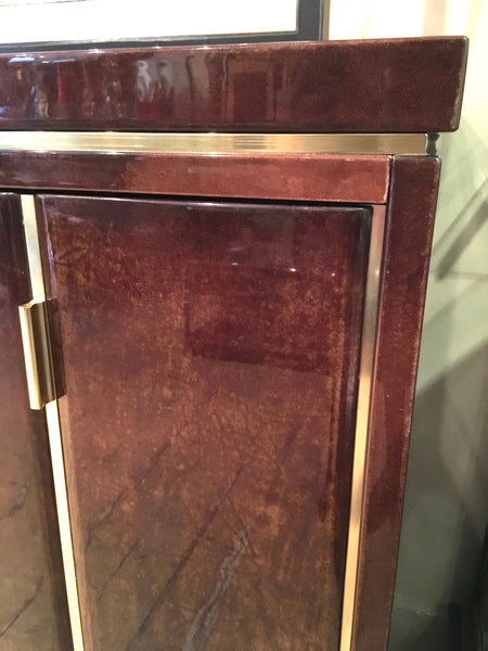 Highly decorative lacquered goatskin sideboard with polished brass details . Italian circa 1970.